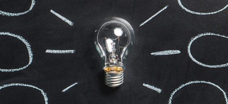 a lightbulb on a blackboard