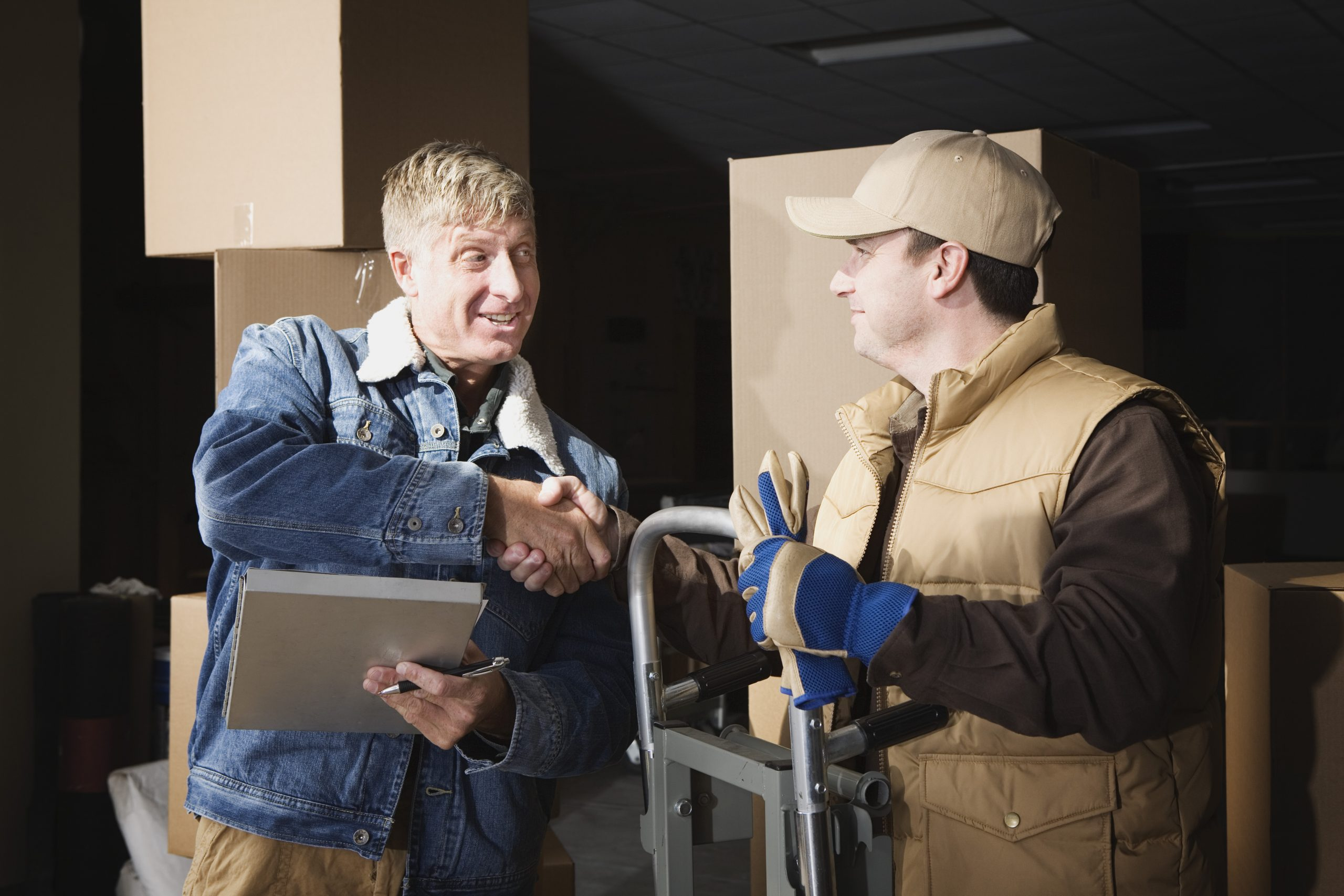 Customer shaking hands with deliveryman