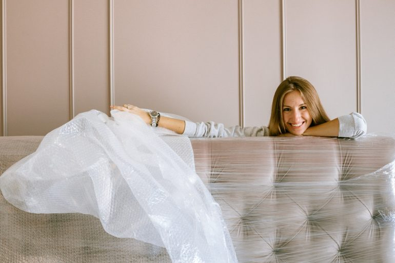 woman with wrapped sofa