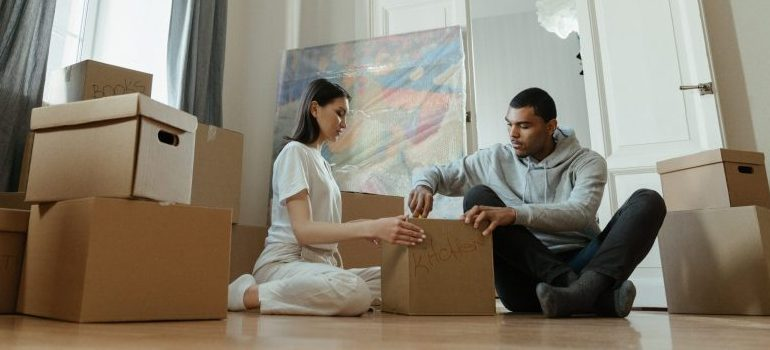 """movers Scarborough ME packing a box labeled """"kitchen"""""""