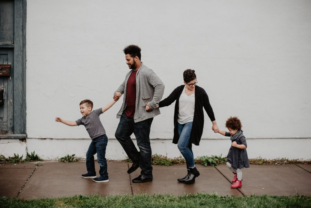 parents walking with their kids