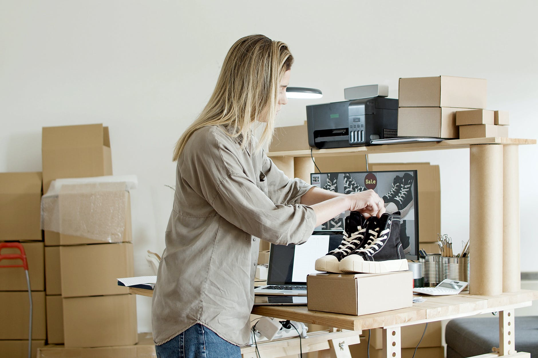 Woman packing shoes and knowing what items you should never keep in your NH storage