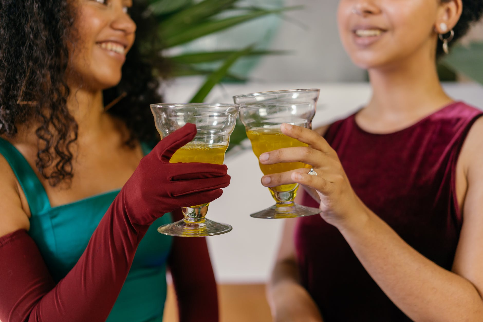 Women cheering their drinking glasses