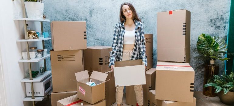 woman packing boxes before moving to Wells